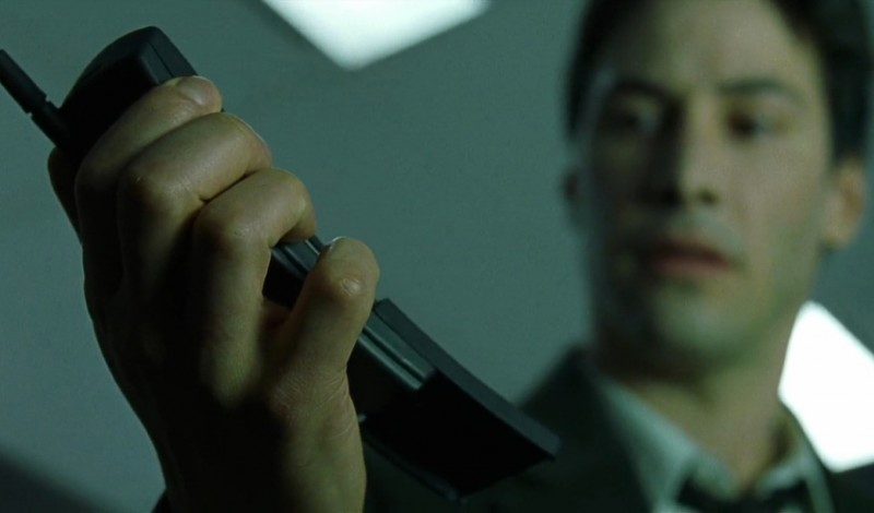 Neo holding Nokia phone
